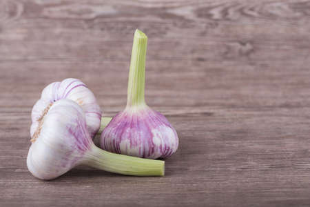 Big brown garlic on a wooden background Stock Photo - 21257747