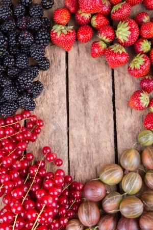 berry fruit: Blueberry, red currants , gooseberries and blackberry background Stock Photo