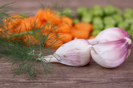 fresh vegetables for soup on a wooden background