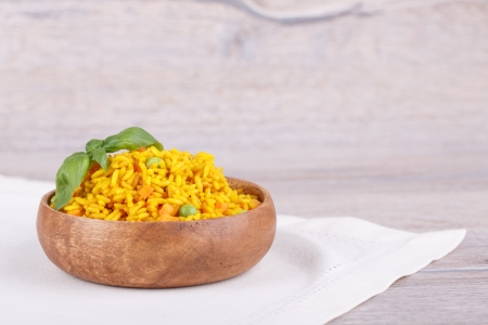 rice with green peas on a wooden background Stock Photo