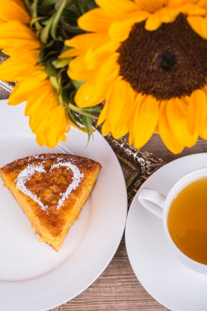 Fresh Homemade Pumpkin Pie with sunflower on wooden background photo