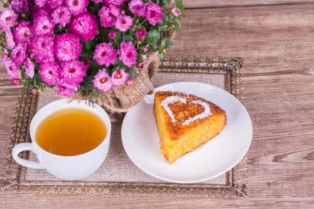 Fresh Homemade Pumpkin Pie with chrysanthemum  on wooden background Stock Photo - 22601314