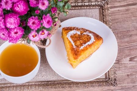 Fresh Homemade Pumpkin Pie with chrysanthemum  on wooden background Stock Photo - 22601316