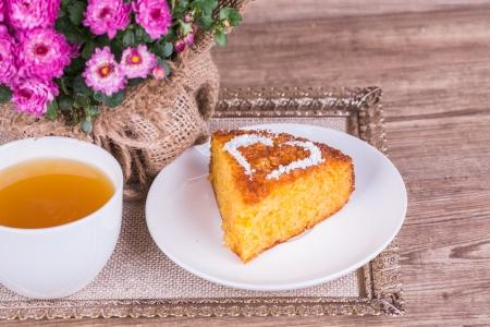 Fresh Homemade Pumpkin Pie with chrysanthemum  on wooden background Stock Photo - 22601317