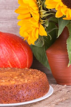 Fresh Homemade Pumpkin Pie with pumpkin on wooden background Stock Photo - 22601337