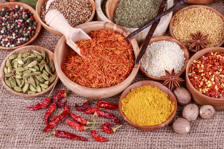 food additives: Various spices and herbs on a sack cloth Stock Photo
