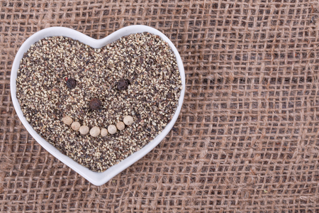 pounder: pepper in  cup in the shape of heart on sack  cloth