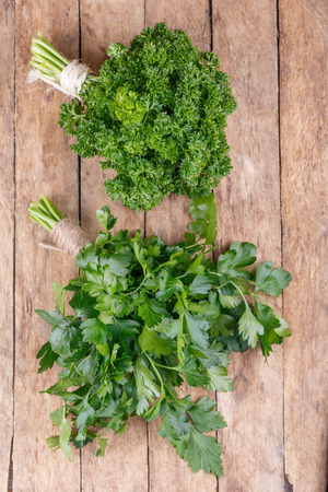 fresh green parsley on a wooden background