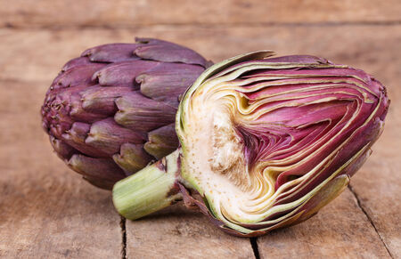 fresh exotic purple artichoke on wooden background
