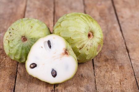 Tropical custard apple fruit on wooden background