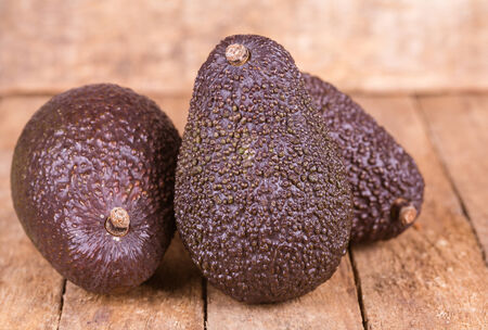 hass: fresh healthy avocado on a wooden background