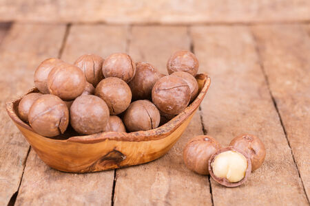 healty macadamia nuts on a wooden background photo