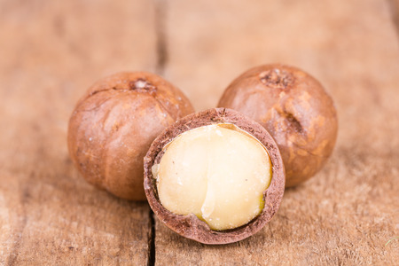 healty: healty macadamia nuts on a wooden background