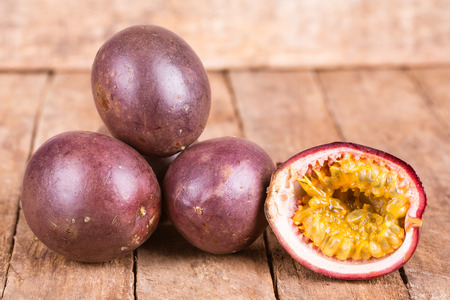 fresh ripe passion fruit on a wooden background