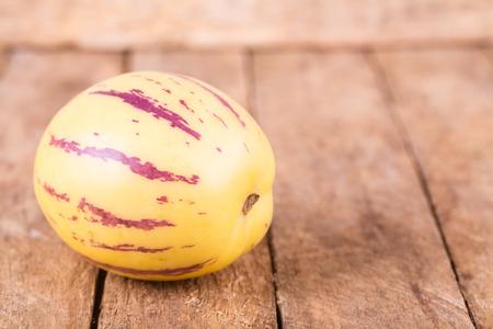 pepino: juicy, fresh fruit pepino melon  on wooden background