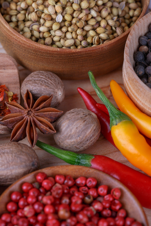indian mustard: Different dry  spices on a  wooden background