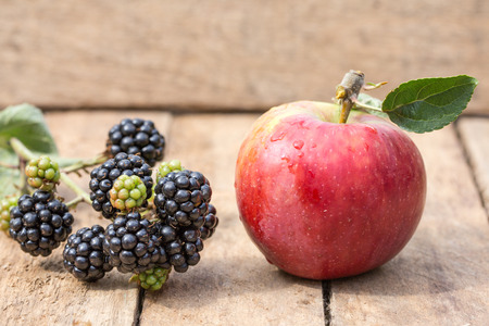 apple and blackberry on a wooden background Stock Photo