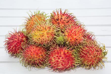 thailand fruit: Thailand fruit rambutan on wooden Background