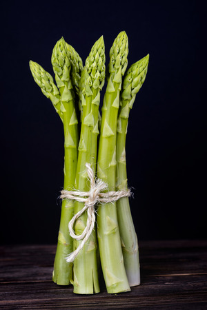 Fresh, green Asparagus on a  wooden table