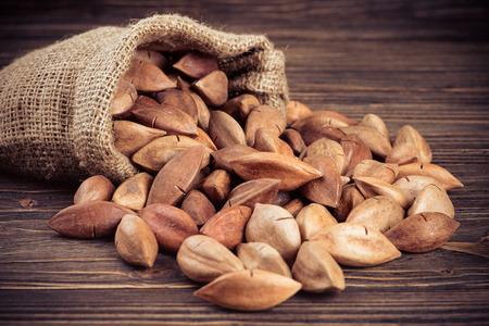 pili: pili nuts on wooden background
