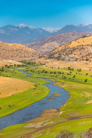Mountain river valley landscape. River valley in mountains.