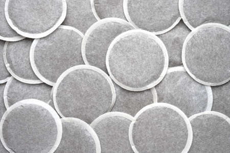 Many coffee pods with coffee as background
