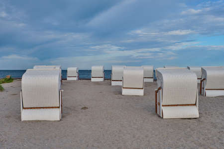 Empty beach cabins on a deserted beach. Imagens