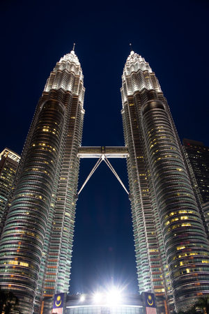 The modern and high petrona towers at night time in Kuala Lumpur, Malaysia Editorial