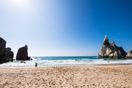 View from the sand of Praia da Ursa beach on a sunny day, Portugal
