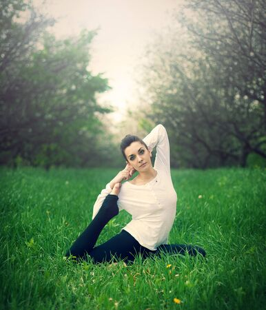ideally: beautiful girl is engaged in yoga in the forest Stock Photo