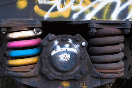 freight train: Close-up of rusted springs on freight train boxcar, Sterling, Colorado Stock Photo