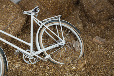time bound: Old bicycle with hay bale with retro effect