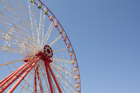 ferriswheel: Carnival Ferris Wheel with Clean Skies with Empty Space Close up shot of half of a ferris wheel Copy space