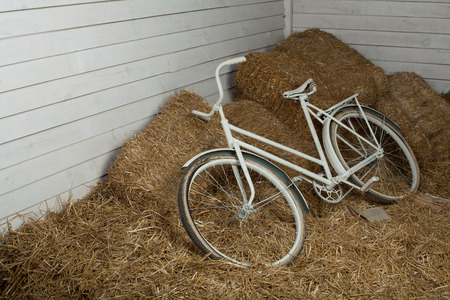 sears: Old white bicycle with hay bale with retro effect