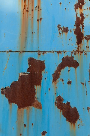 A rusty blue corrugated iron metal texture.