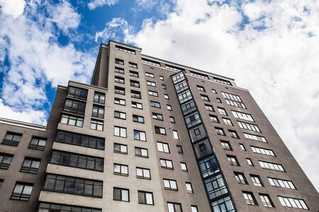 Modern, Luxury Apartment Building with clody blue sky on the background Stock Photo