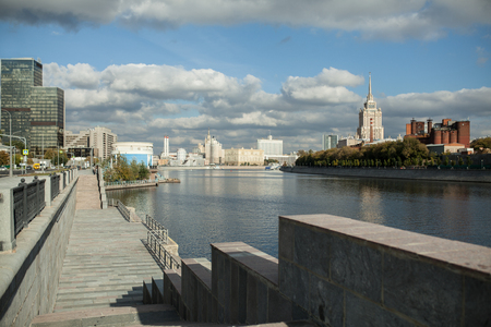 Summer view on the Moscow river with Radisson hotel on the background and cloudy sky Stock Photo