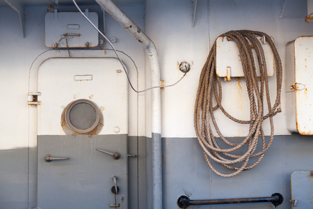 Modern ship door and windows with rope
