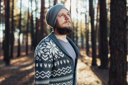 Outdoor portrait of handsome bearded man . Casual autumn fashion portrait Hipster in the forest Stock fotó
