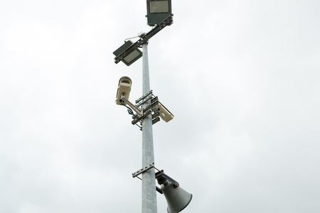 Security CCTV cameras and loudspeaker mounted on the post for street surveillance 写真素材
