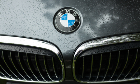 Crozon, France - May 29th, 2018: Bmw motor company badge on the front from a black car. BMW is a German automobile, motorcycle and engine manufacturing company founded in 1916.