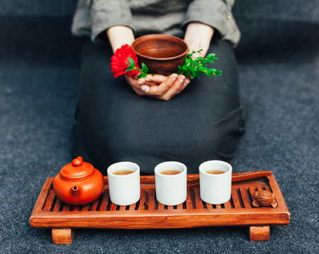 Chinese tea ceremony Asian wooden table board chaban top view copy space morning energy. Breakfast green hot drink with caffeine traditional classic crockery tea set clay ceramic pot cups nature woods Reklamní fotografie