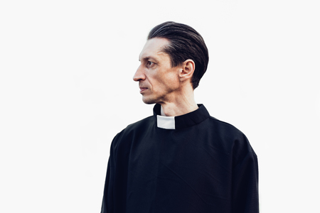 Portrait of handsome catholic priest or pastor with collar Standing isolated on the white background