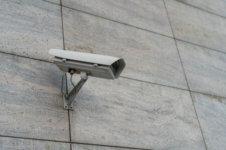 CCTV cameras are installed along the streets. To check traffic conditions and take care of safety Big brother is watching you concept