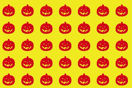 Red halloween pumpkins on the orange background Isolated. paper for wrapping