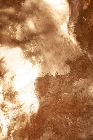 Gold chemical dirty colored water background close up. 版權商用圖片