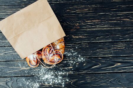 Mock up. Healthy tasty breakfast. Top view, copy space. Bakery on the white Wooden background. French breakfast. Paper package. Breakfast food table.