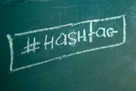 Closeup on hashtag symbol white chalk on a green blackboard copy space background