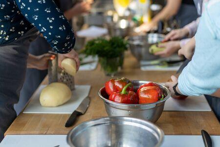 Unrecognizable large family preparing dinner for the holiday. Unrecognizable large family preparing dinner for the holiday.