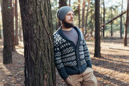 Outdoor portrait of handsome bearded man . Casual autumn fashion portrait Hipster in the forest Stok Fotoğraf